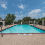 outdoor pool with chair lift at Super 8 by Wyndham Fort Worth South